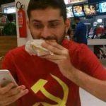 "Communist tweets ""Death to Capitalism"" on iPhone while slamming down Big Mac"