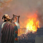 Macron caught fiddling as Paris burns to the ground
